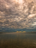 Low and dark clouds over Danube river before a storm in Belgrade Stock Images