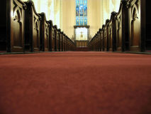 Low down the aisle. View of the altar past the pews down the aisle low perspective stock photography