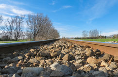 Low Down Railway Track. A low view of railway tracks on a sunny day Royalty Free Stock Photos