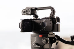 Low End Professional Video Camera On Fluid Head Tripod Royalty Free Stock Images