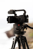 Low End Professional Video Camera On Tripod Stock Images
