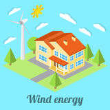 Low-energy house with wind turbine.  Stock Photos