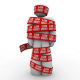 Low Energy Man Wrapped Out of Fuel Starving Diet. A man is wrapped in tape with the words Low Energy to illustrate being starved due to diet or having a vitamin Stock Photography