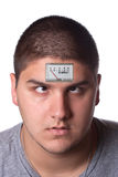 Low Energy Meter Man. Conceptual image of a young man with a low energy meter on his forehead to illustrate tiredness Royalty Free Stock Photos