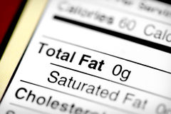 Low in fat. Nutritional label with focus on fats Royalty Free Stock Photography