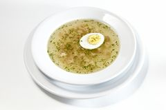 Low-fat chicken broth with a half cooked egg Stock Photos