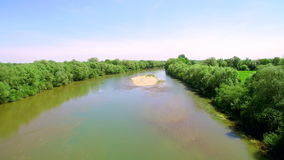 Low flight. Aerial View 4k. Flying over the beautiful River. Aerial camera shot. Landscape panorama. stock video footage