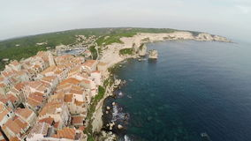 Low flight over old city Bonifacio at golden sunset colors. Corsica, France. Aerial view. stock footage