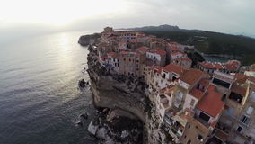 Low flight over old city Bonifacio at sunset colors. Corsica, France. Aerial view. stock video