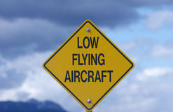 Low flying aircraft Stock Images