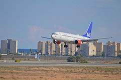 Low Flying Aircraft - SAS Passenger Flight Plane. The SAS Scandinavian Airlines flight about to touch down at Alicante airport Royalty Free Stock Photography