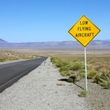 Low flying aircraft sign on highway. Stock Photography