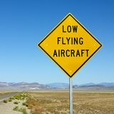Low flying aircraft sign on side of highway. royalty free stock photo
