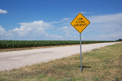 Low Flying Aircraft warning sign. Along dirt road near rural airport Royalty Free Stock Photos