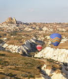 Low flying balloons ravine Uchisar Turkey Royalty Free Stock Image