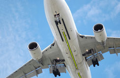 Low flying jet. Close-up of a large low flying jet aircraft Stock Images