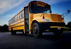 Low front angle shot of a public school bus. View of yellow elementary school bus for transportation of students stock photo