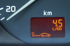 Low fuel consumption showed by the car on-board computer on the dashboard