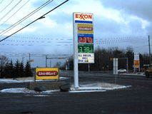 Low Gas Prices. An Exxon gas station at dusk advertising lower prices in Pocono Summit, Pennsylvania Stock Photos