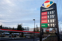 Low Gas Prices at Fred Meyer Fuel Station in Portland Oregon. PORTLAND, OR - FEBRUARY 27, 2016: Low gasoline prices shown on a sign at a Fred Meyer gas station Royalty Free Stock Photos
