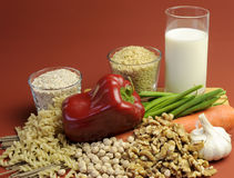 Low GI Foods for healthy weight loss slimming diet. Low GI Foods - milk, brown rice, oatmeal, red capsicum pepper, green beans, garlic, raw carrot, walnuts Stock Images