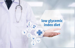 Low glycemic index diet. Medicine doctor hand working  Professional doctor use computer and medical equipment all around, desktop top view Stock Photo