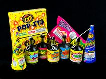 Low Grade hand held fireworks like Pop Its and Party Poppers on a black backdrop Royalty Free Stock Image