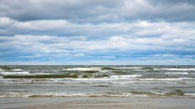 Low gray clouds over water of Baltic Sea Royalty Free Stock Photos