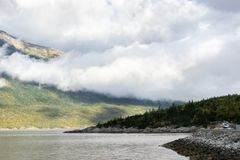 Low hanging clouds over mountainside coastlines in scenic Skagway, Alaska royalty free stock photos