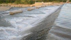 Low head dam - Weir on Secchia River. Near Sassuolo n- Modena - footage taken on 04 29 2018 stock footage