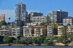 Low and High rise residential units facing the sea next to Jeffrey Street Wharf. Expensive houses along the coast of North Sydney around Kirribilli neighbourhood Royalty Free Stock Image