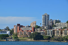 Low & High rise residential units with Jeffrey Street Wharf on the left. Expensive houses along the coast of North Sydney around Kirribilli neighbourhood nearby Royalty Free Stock Images