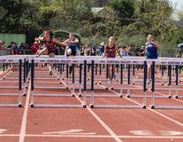 Low Hurdles  Race at the Track Meet Stock Photos