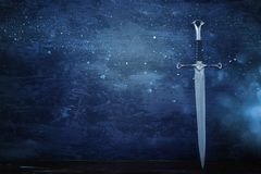 low key banner of silver sword. fantasy medieval period. stock image