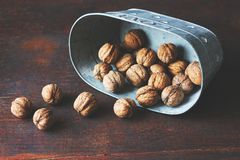 Pile of walnuts beautifully falling out of a bowl royalty free stock images