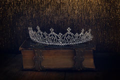 Low key of diamond queen crown on old book Royalty Free Stock Photos