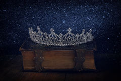 Low key of diamond queen crown on old book Royalty Free Stock Images