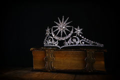 Low key of diamond queen crown on old book Stock Images