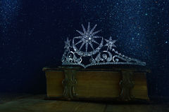 Low key of diamond queen crown on old book Stock Image
