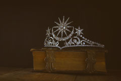 Low key of diamond queen crown on old book Stock Photography