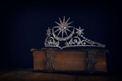 Low key of diamond queen crown on old book Royalty Free Stock Photo