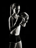 Low key female boxer. Low key artistic studio shot of a female boxer Royalty Free Stock Images