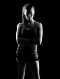 Low key fitness woman Royalty Free Stock Images