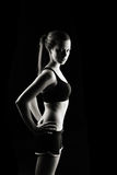 Low key fitness woman. Low key artistic studio shot of fitness woman on black Royalty Free Stock Photo
