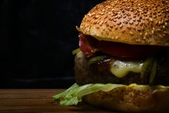 Low key fresh beef burger close-up Royalty Free Stock Photography