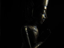 Low Key Golden Buddha profile Royalty Free Stock Image