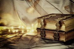 Low key image of antique story book. selective focus. Low key image of antique story book. selective focus Stock Photos