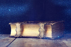 Low key image of antique story book. vintage filtered. With glitter overlay. selective focus royalty free stock photos