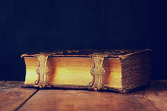 Low key image of antique story book. vintage filtered. Selective focus Stock Images