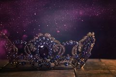 Low key image of beautiful queen/king crown. fantasy medieval period. Selective focus. Low key image of beautiful queen/king crown. fantasy medieval period stock images